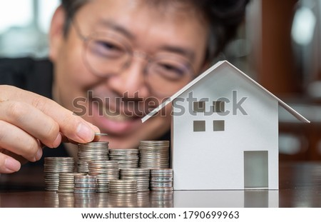 Model houses and stacked coins. Home equity loans. Mortgages and loans. Stock photo ©