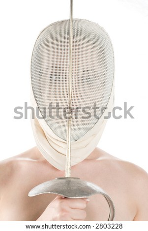 Model in fencing face mask with sword