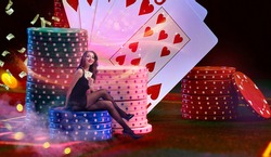 Model is holding two aces, sitting on stacks of chips on green playing table. Colorful background with cards, flying dollars and coins. Poker, casino