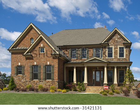 Model Luxury Home Exterior front view clouds column porch