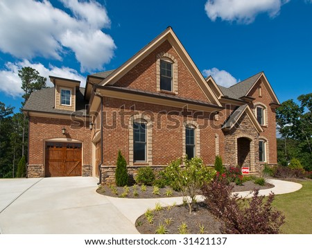 Model Luxury Home Exterior side view with clouds