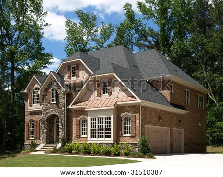 Model Luxury Home Exterior side view with tree background