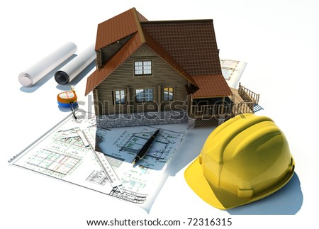 Model of a house on a table - stock photo