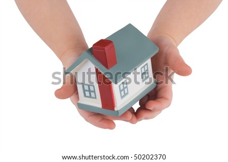 Model of a house on child's hands isolated on white