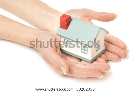 Model of a house on hands isolated on white