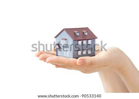 Model of a house on hands isolated on white background