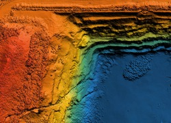 Model of a mine elevation. GIS product made after processing aerial pictures taken from a drone. It shows excavation site with steep rock walls
