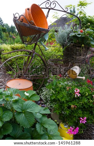 Model of an old bicycle equipped with baskets of flowers.