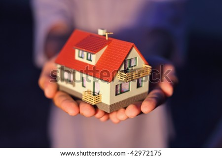 model of house on hands