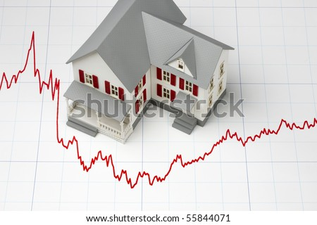 Model of house shot on graph depicting mortgage rates - stock photo