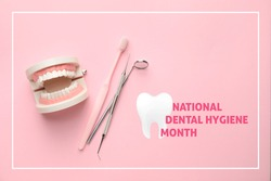 Model of jaw with toothbrush and dentist's tools on color background. National Dental Hygiene Month