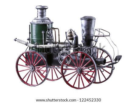 Model of old-fashioned train isolated over white background