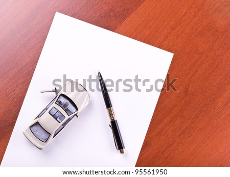 Model of the car and pen on paper
