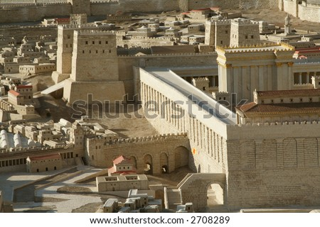 Model of the 2nd temple in Jerusalem with an arrow highlighting the western wall