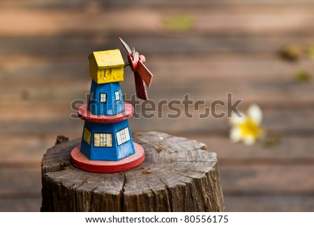 Model of windmill on the log