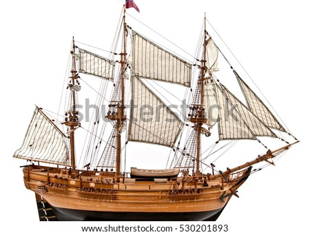Model of wooden sailing ship with three mast, isolated on white\n