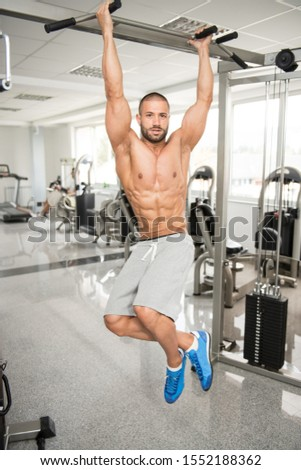 Model Performing Hanging Leg Raises Exercise - One Of The Most Effective Ab Exercises