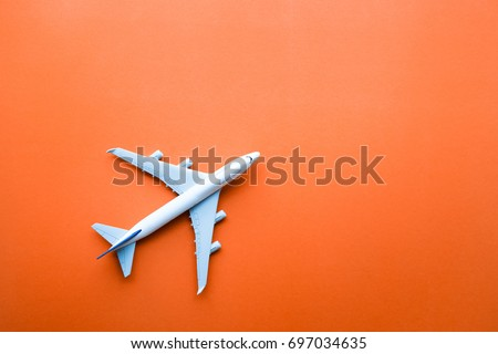 Model plane,airplane on pastel color background.Flat lay design. stock photo