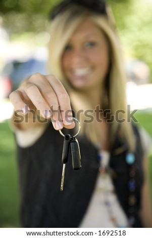 Model Release 358  Teenage girl holding out the keys to her car