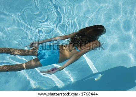 Model Release 358  Young girl swimming under water