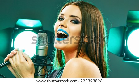 Model rock star singer. Sound studio music concept.