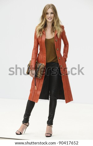 model, Rosie Huntington Whiteley arrives for the Burberry Prorsum SS'12 catwalk show in Kensington Gardens as part of London Fashion Week. 19/09/2011  Picture by Steve Vas/Featureflash