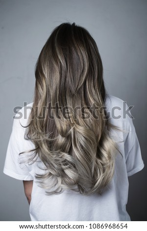 Model showing her Grey colored hair, back view Foto stock ©