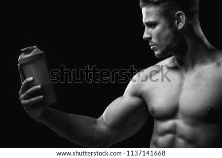 Model sports young man on dark background. Black and white portrait of  muscle guy with 94ece7e9b7