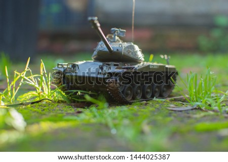 model tank, M4. Tamiya, battles in garden, grass and light.