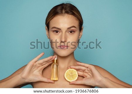 Model Using Natural Cosmetic Product For Hydrated, Glowing And Healthy Facial Derma. Essential Oil For Anti-Aging Therapy. Serum with vitamin c Zdjęcia stock ©