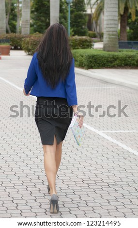 Model walking away from the camera.