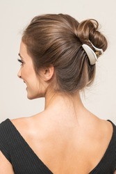 Model With Hair Clips, posing, close up.