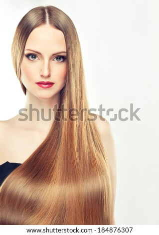 Model with long and shining hair.