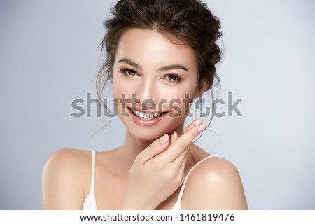 model with perfect smile and beautiful face isolated on grey, pure beauty portrait of young and happy woman
