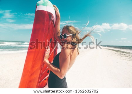 Model with watermelon lilo at the beach. Summer vacations, idyllic scene. #1362632702