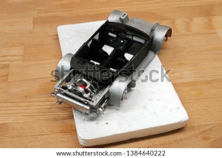 Modeling scale models. Assembling the cabin of a toy car. Installed seats, gearshift lever, dashboard. Mounted on the frame.