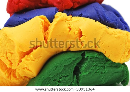 modelling clay of different colors isolated on a white background