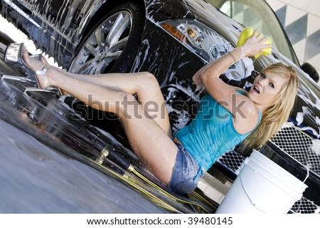 Models at the car wash - stock photo