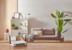 Modem and router box on the table and living room background blur concept.