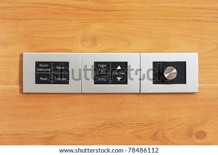 moderm switch control in hotel room - stock photo