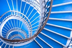 Modern abstract spiral staircase, bauhaus style, modern architecture, blue and golden staircase,psychedelic abstract stairs from above, spiral pattern