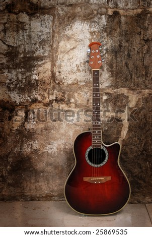 Modern acoustic guitar on wall