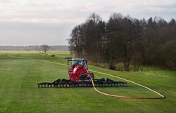 Modern agriculture: injection of liquid manure in grass land using a drag hose applicator