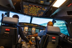 modern airbus airplane cockpit with pilots during a training session in a full flight simulator