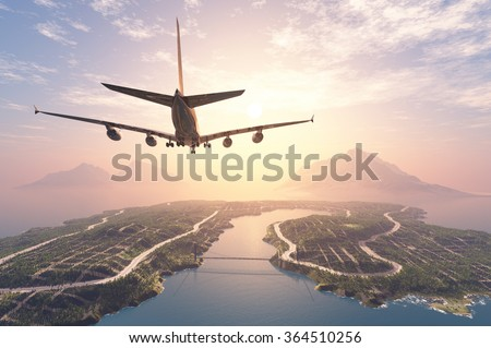 Modern aircraft flies over the island. stock photo