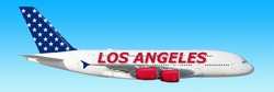 Modern airplane in USA flag colors with Los Angeles lettering on aircraft body flying isolated on blue sky background aerial wide banner side view of plane. Air travel world city destination flight
