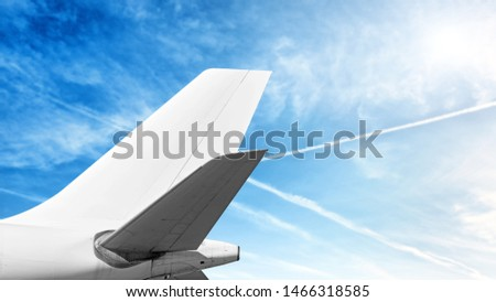 Photo of  modern airplane tail isolated on cloud sky background side view of commercial passenger jet aircraft with wide body cargo plane parts like white fuselage fin wing air travel copy space template