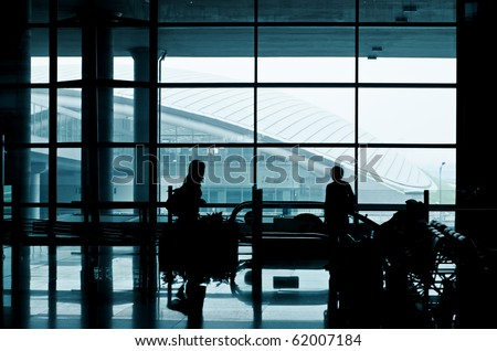 Modern airport interior with people.
