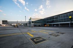 Modern airport terminal. Jet bridge. Passenger boarding bridge.
