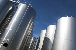 Modern aluminum barrels where grape juice is aged into wine, France